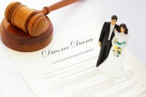 Gavel on top of divorce decree document and wedding topper